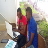 Mcharo Jeff & Antony undertaking an assignment.They are pursuing Bachelor of Education at Mombasa